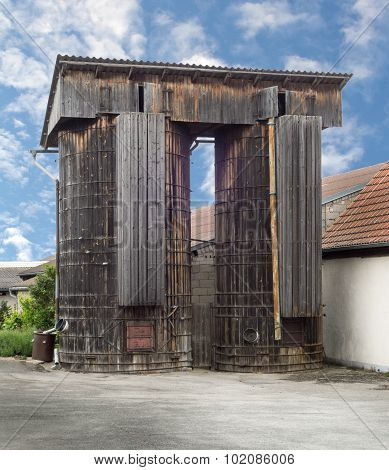 Two old silos made of wood