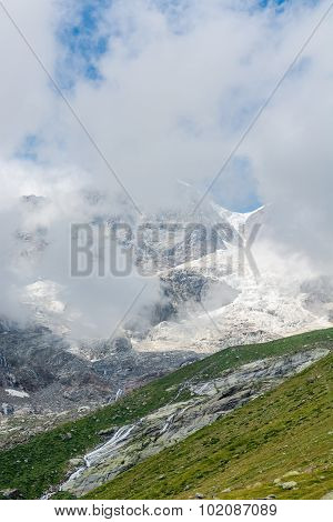 Mountain peak covered with clouds.