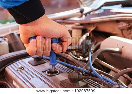 Hand With Wrench For Spark Plugs