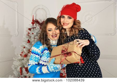 two friends girls given present . funny celebration a new year or christmas.
