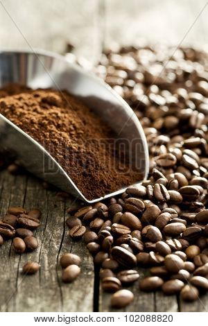 coffee beans and ground coffee in scoop