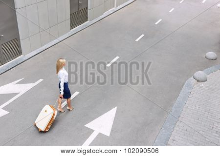 Attractive woman going along the road