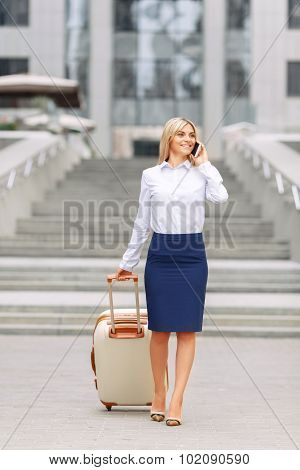 Nice woman standing near office building