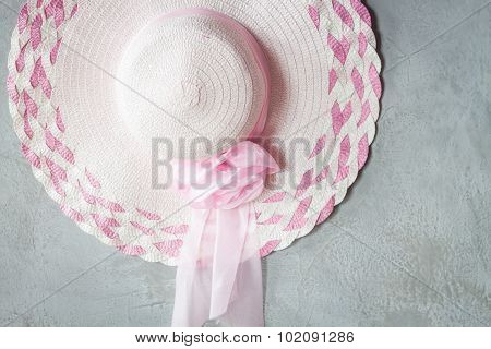 Pink Hat With Ribbon On Grey Background