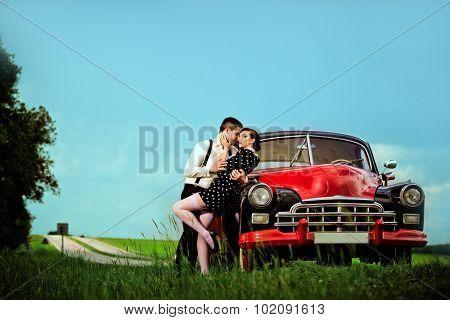 Young couple next retro car