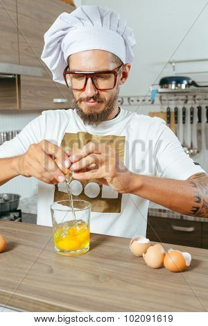 Food and people concept - happy male chef cook over kitchen background