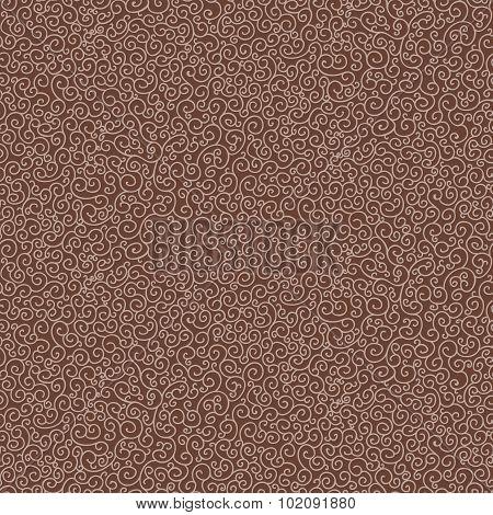 Seamless pattern of spirals beige on a brown background