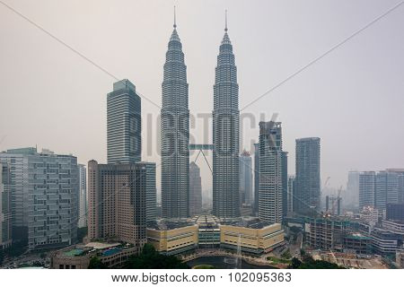 KUALA LUMPUR - SEPTEMBER 17, 2015: Smoke from forest fires in Sumatra blows across the Malay Peninsula causing haze in Kuala Lumpur City Center.