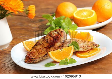 Grilled chicken breast with orange and mint