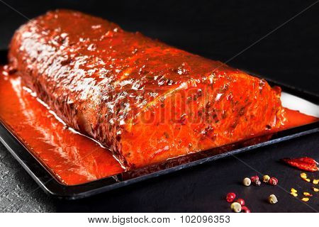 whole piece of marinated pork ready to cook
