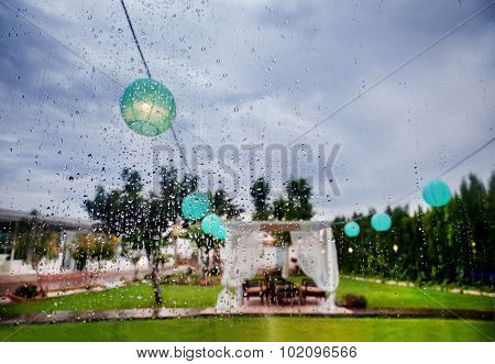 Outdoor ceremony. Decoration of celebrations. Rain through the window