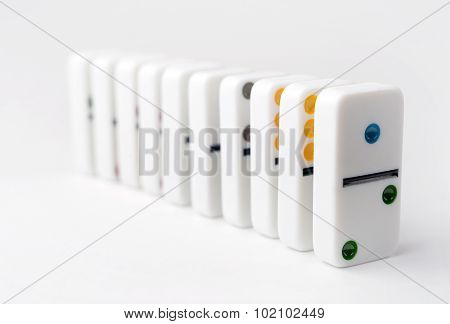 The Domino Effect Of White Blocks, With Colorful Numbers. Selective Focus On The Front Part Of The D