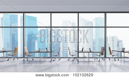 Workplaces In A Modern Panoramic Office, Singapore City View. Open Space. Black Tables And Brown Lea