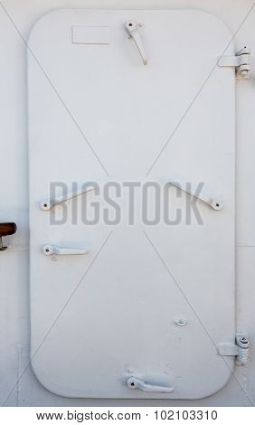 Massive metal watertight door on the sailboat