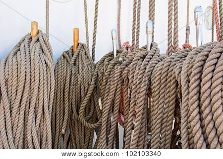 Bundle of various old twisted ropes close up