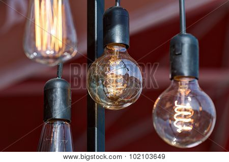 Different vintage glowing lamps