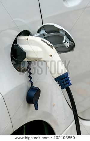 electric car at charging station. symbol of ecology, climate change, innovation