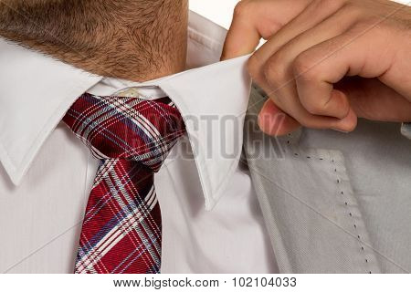 a man (manager) feels concentrated. the collar bursts.