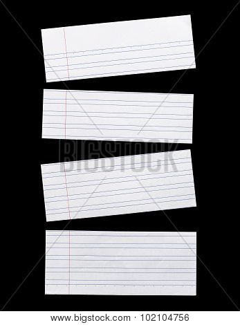 Close Up Piece Of White Lined Paper Isolated On Black