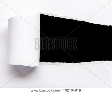 Close Up Ripped White Paper Isolated On Black