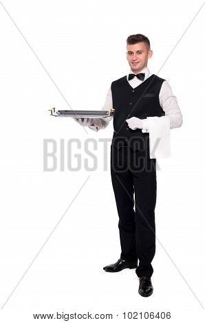 Portrait Of Young Happy Smiling Waiter With On Tray Isolated On White Background