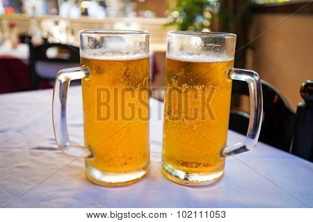Two pints of beer on the restaurant table