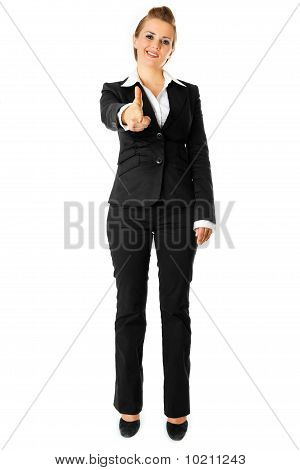 full length portrait  cheerful modern business woman pointing finger at you