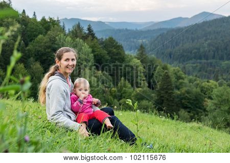 Mum with child on background of mountains