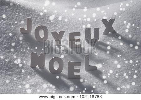 White Word Joyeux Noel Means Merry Christmas On Snow, Snowflakes