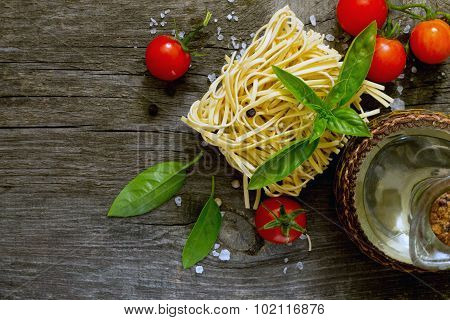 Egg Noodles, Sunflower Oil And Fresh Cherry Tomatoes On A Dark Gray Background