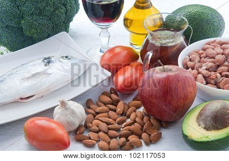 10 Foods To Lower Cholesterol : Tea , Avocado , Fruit , Vegetables,walnuts , Almonds , Fish , Wine