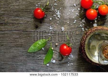 Sunflower Oil And Fresh Cherry Tomatoes On A Dark Gray Background