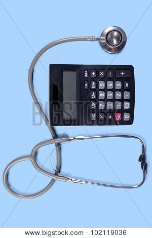 Closeup Of Stethoscope With Calculator