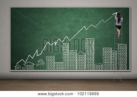 Female Worker Drawing Real Estate Chart