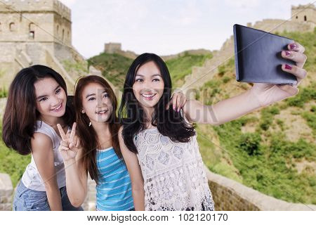 Group Of Teenage Girls Taking Photo
