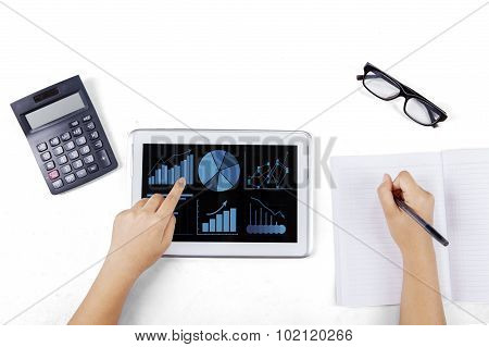 Hand Touching Business Chart On Tablet