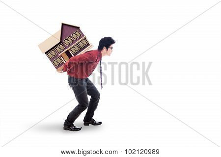 Investor Carrying House Model In The Studio