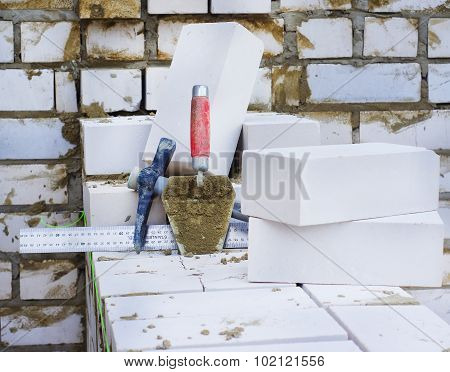 Instruments For Wall Made Of Bricks