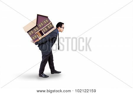Real Estate Business With Worker Carries House