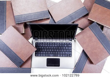 Textbooks And Laptop Computer