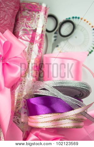 Rolls of pink wrapping paper. Materials and accessories for wrapping gifts