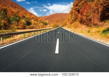 Driving On Asphalt Road Through The Hills At Autumn