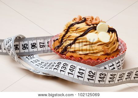 Cupcake With Measuring Tape On Table