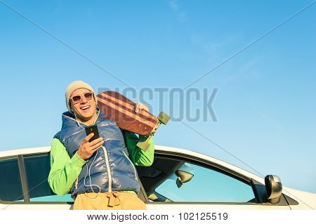 Young Hipster Man With Smartphone Listening Music Next His Car - Concept Of Modern Technologies