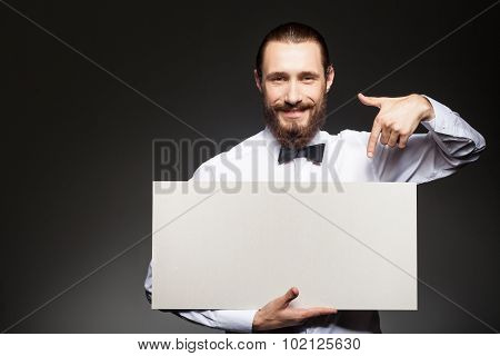 Attractive young guy with beard is carrying placard