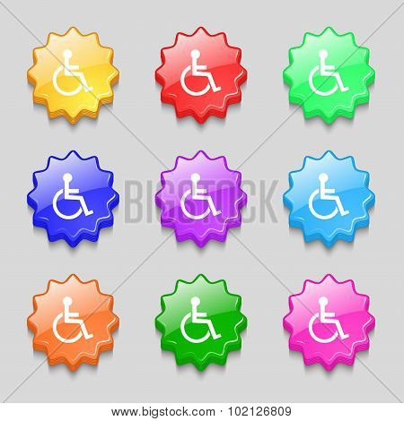Disabled Sign Icon. Human On Wheelchair Symbol. Handicapped Invalid Sign. Symbols On Nine Wavy Colou