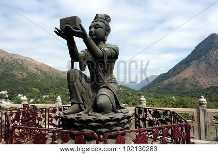 Bodhisattvas offering gift to Buddha - from Tian Tan Buddha Lantau Island Hong Kong China Photo by Rafael Ben-Ari/Chameleons Eye