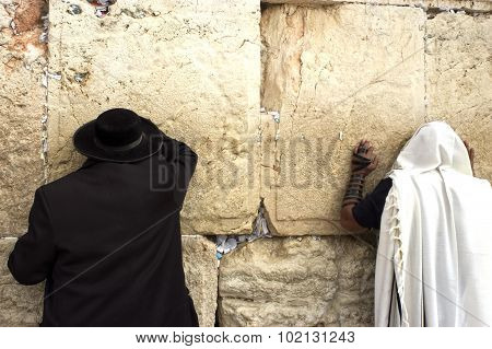 Jewish orthodox men pray at the western wall in the old city of Jerusalem Israel