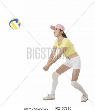 Asian Teenage Girl Hitting A Volleyball