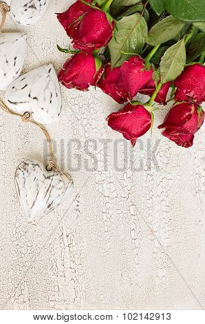 White Wooden Hearts And Red Roses On Old White Wooden Background, Vertical Composition